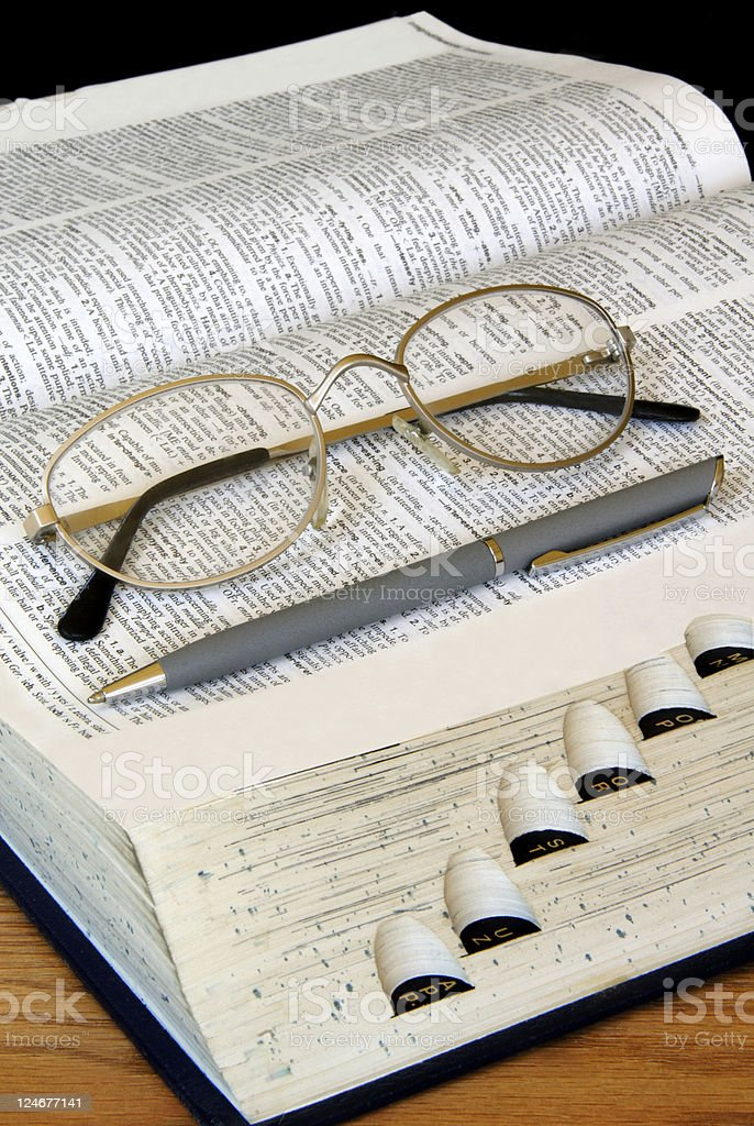 Study Time: Dictionary and Glasses royalty-free stock photo
