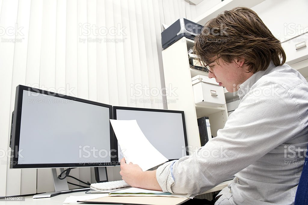 Studying a document stock photo