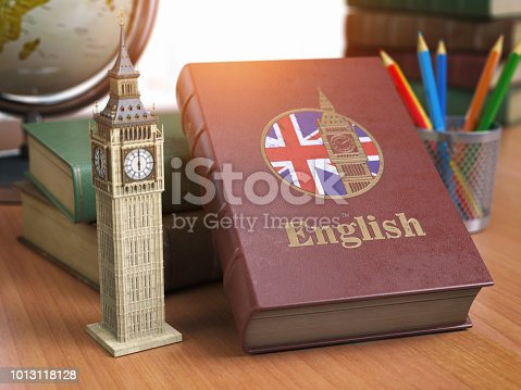 istock Studying and learn English concept. Book with flag of Great Britain and Big Ben tower on the table. 1013118128