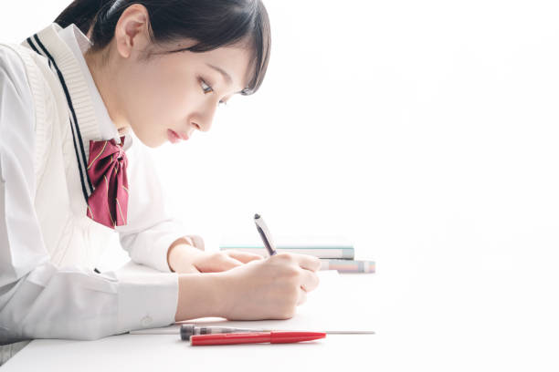 アジアの女子高生を勉強しています。 - 受験 ストックフォトと画像