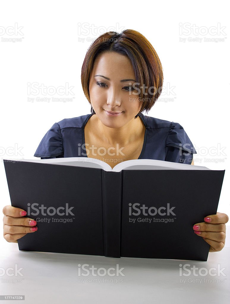 Studying Asian Student Reading a Book stock photo
