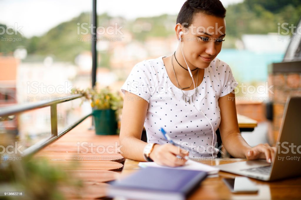 Studying at rooftop cafe stock photo