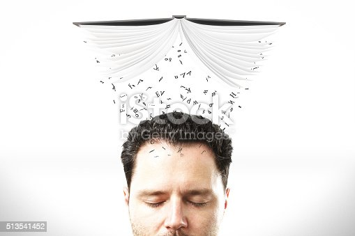 istock Studying concept with man head with opened book 513541452