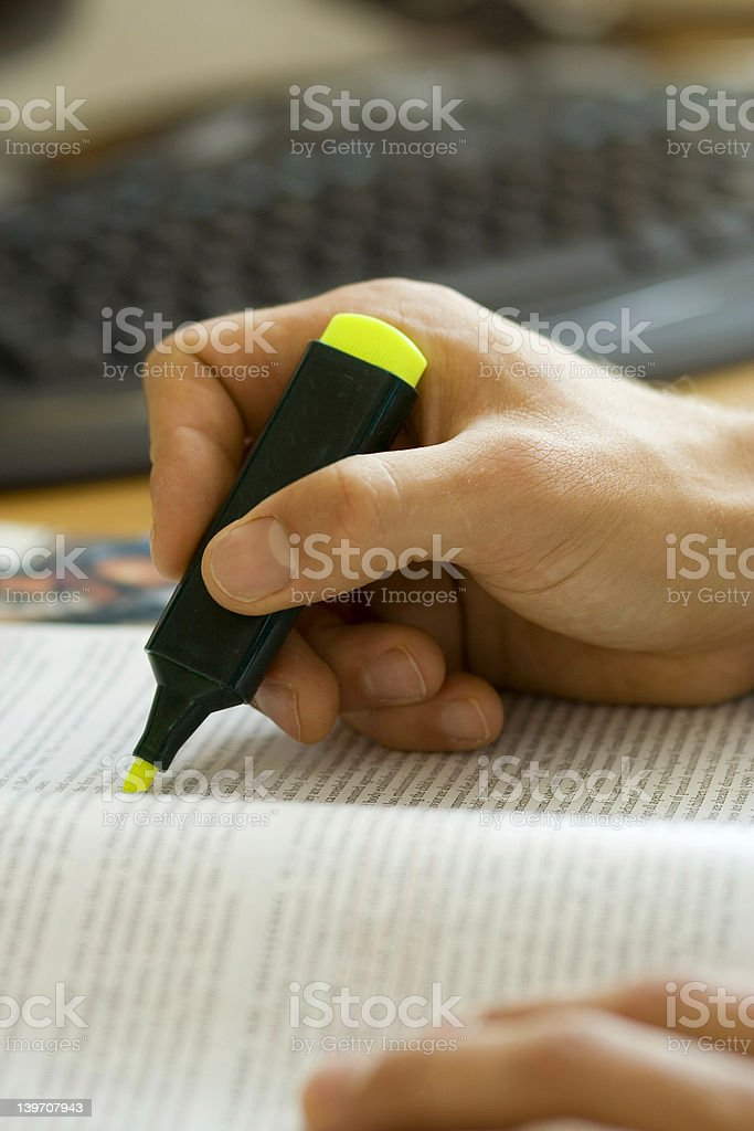 Studying Hard - Young male student stock photo