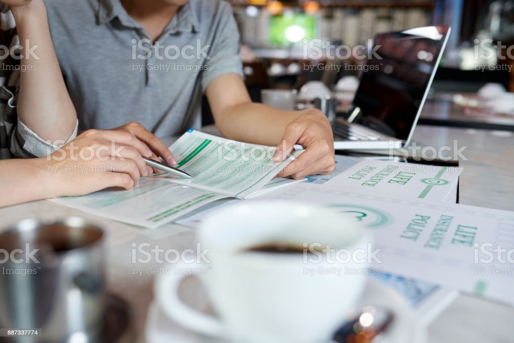 Studying Life Insurance Brochure stock photo