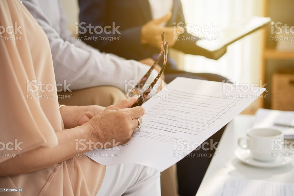 Studying Life Insurance Policy stock photo