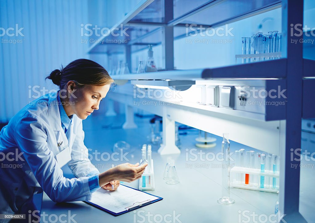 Studying liquids in flasks stock photo