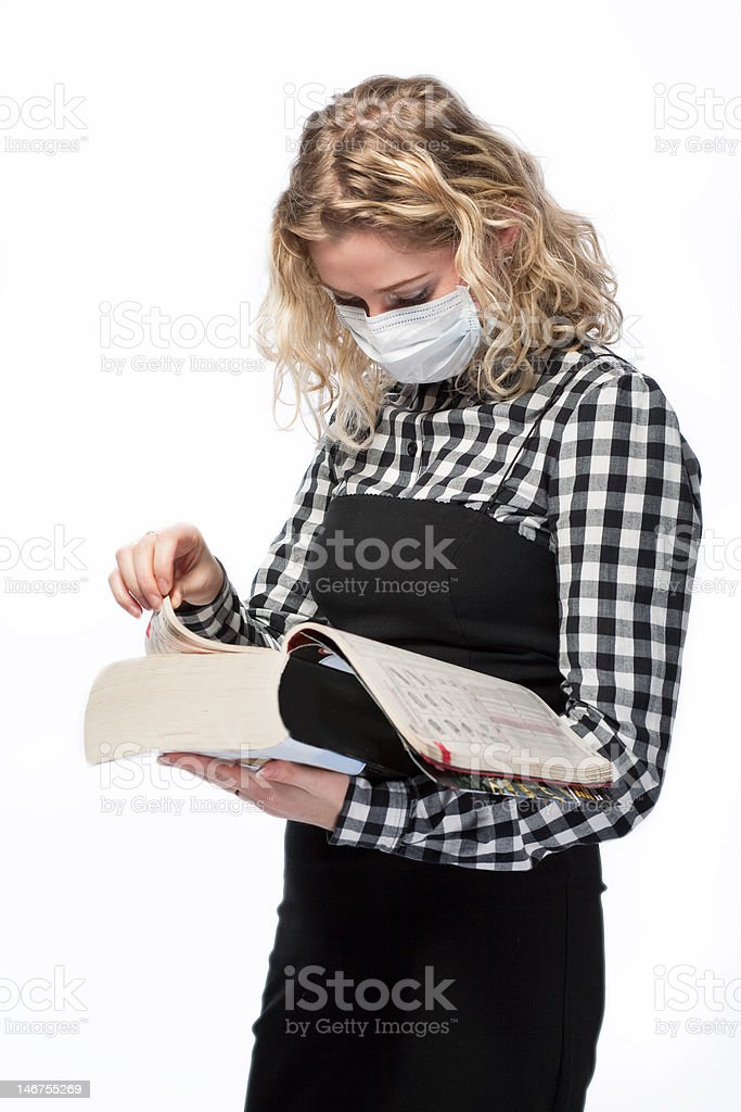 studying medical book stock photo