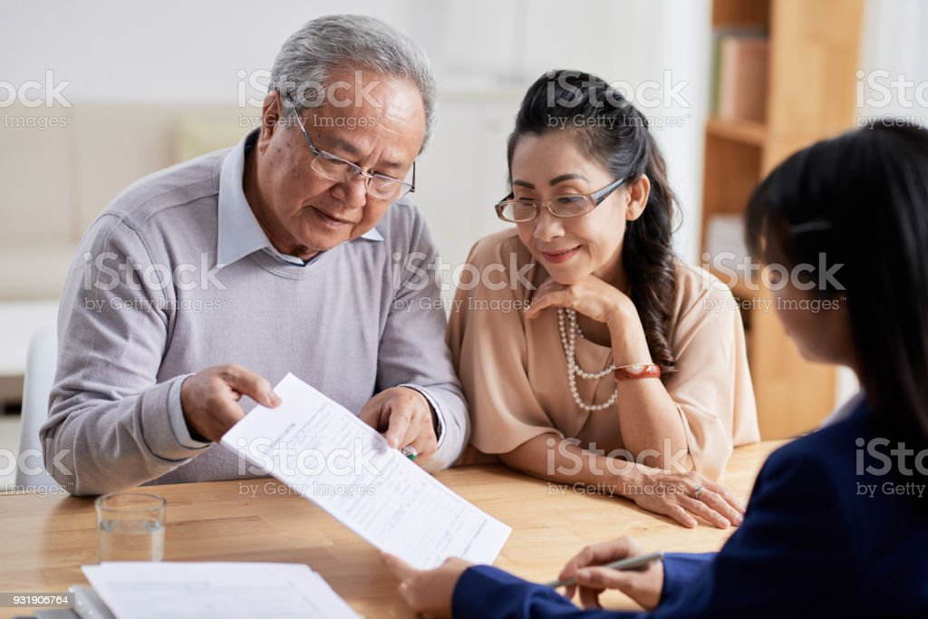 Studying Real Estate Purchase Agreement stock photo