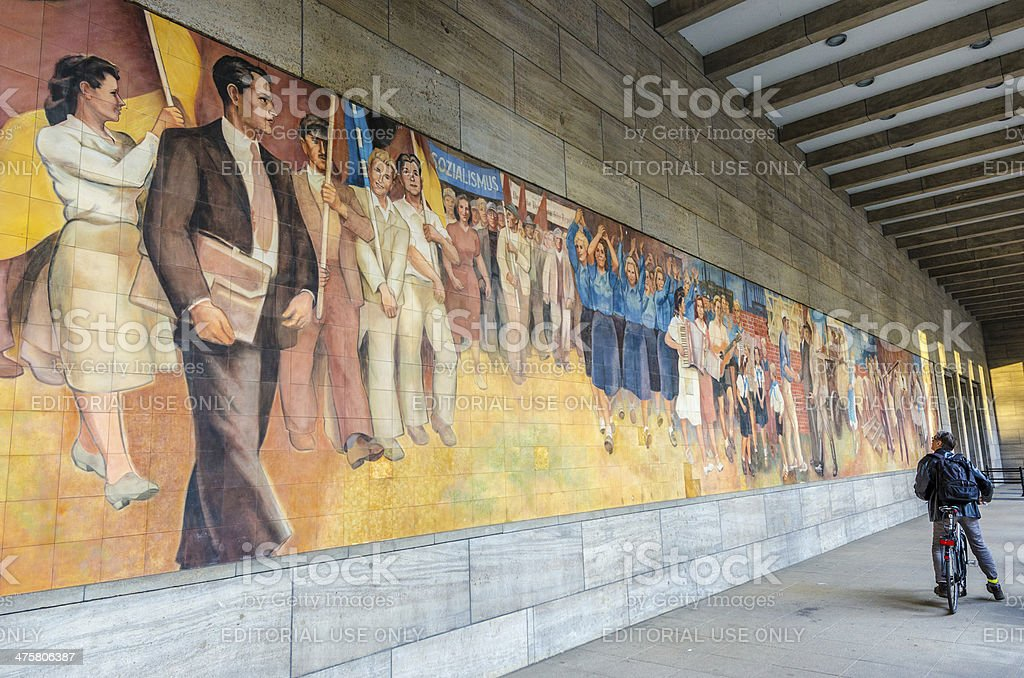 Studying socialist mural in Berlin stock photo