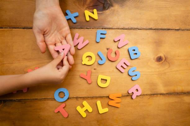 Studying the alphabet stock photo