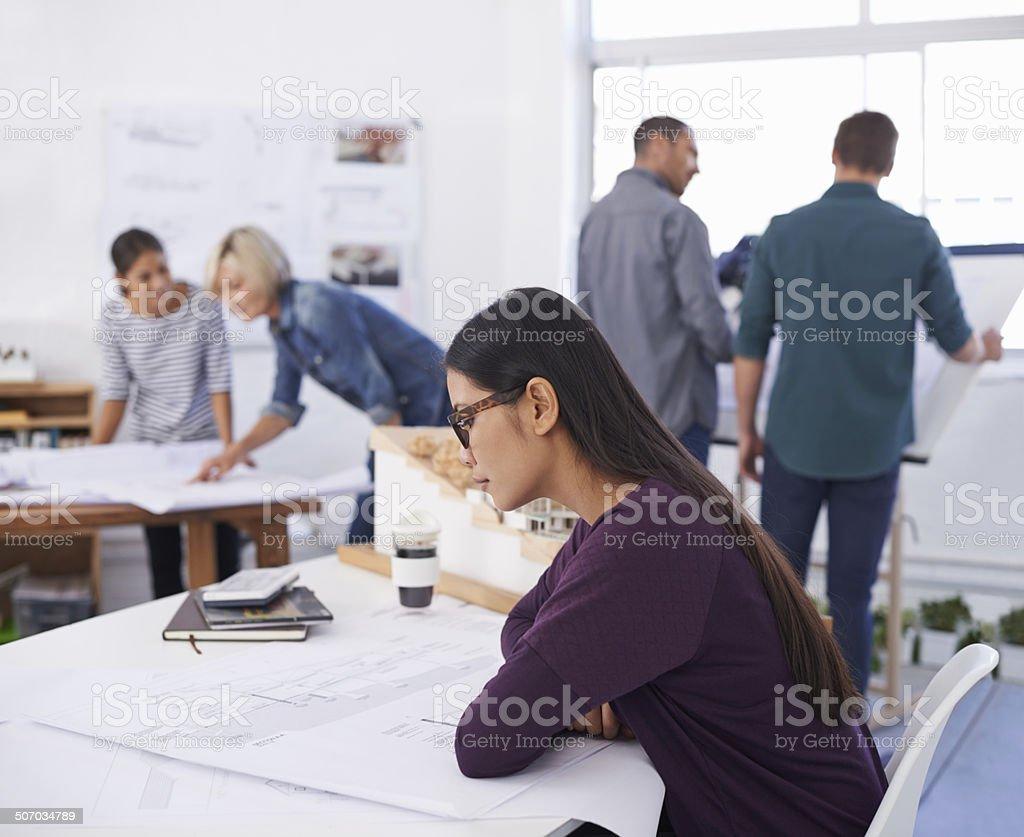 Studying the blueprints thoroughly to eradicate any errors royalty-free stock photo