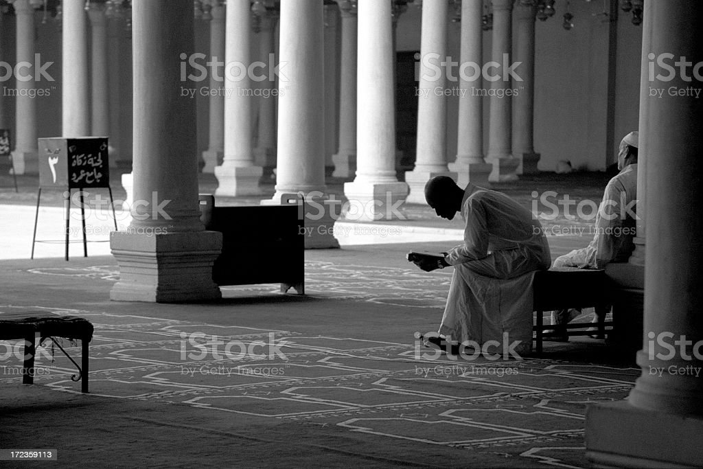 Studying the Koran in a mosque in Cairo, Egypt. royalty-free stock photo