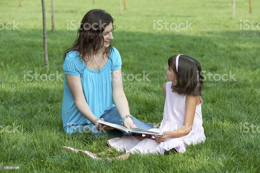 Studying with mum outdoor royalty-free stock photo