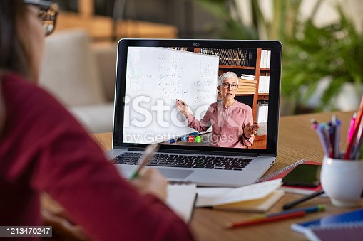 istock Studying with video online lesson at home 1213470247