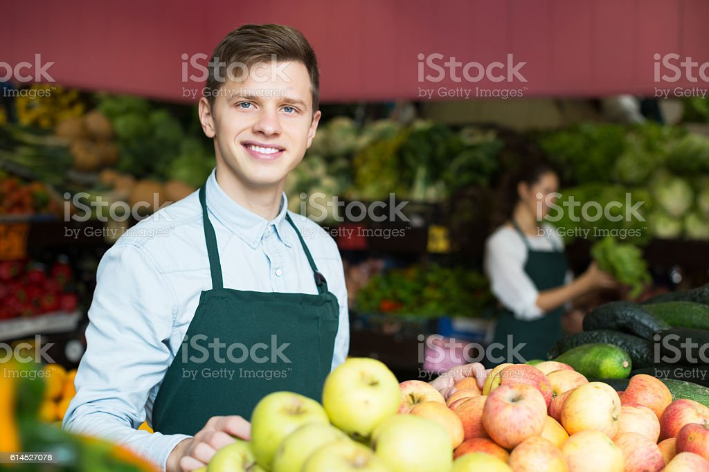 Stuff in apron selling apples stock photo