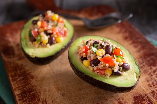 Avocado stuffed with quinoa, black beans, corn, tomato and cilantro