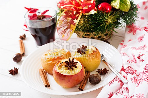 istock Stuffed baked apples with cottage cheese, raisins and almonds for Christmas on a white background. Xmas food dessert. 1049184650