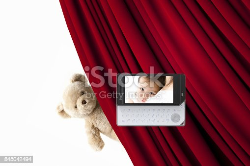 istock Stuffed bears and baby pictures on the mobile screen 845042494