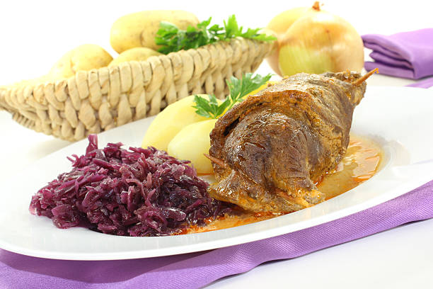 stuffed beef rolls with onions stock photo