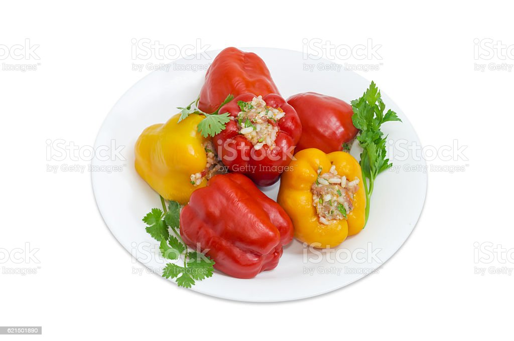 Stuffed bell peppers and twigs of greenery on white dish Lizenzfreies stock-foto