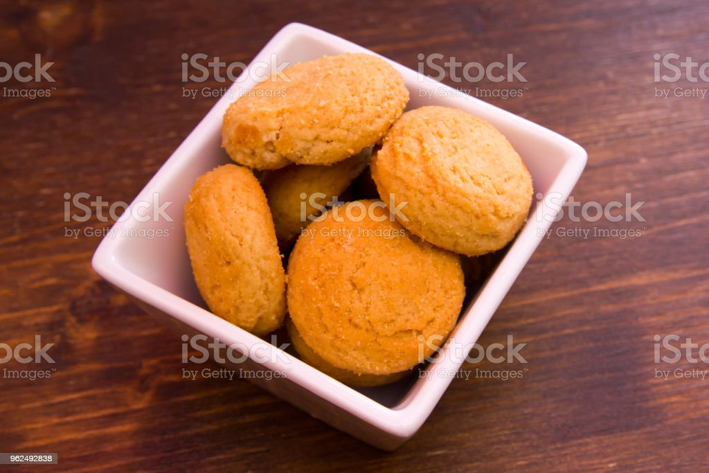 Stuffed biscuits on square bowl on a wooden table seen close up - Royalty-free Baked Stock Photo