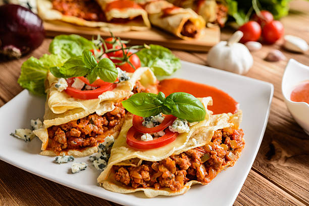 stuffed bolognese pancakes with minced meat and vegetable - savory food stock photos and pictures