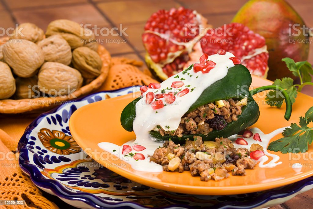 Stuffed green peppers with walnut sauce stock photo