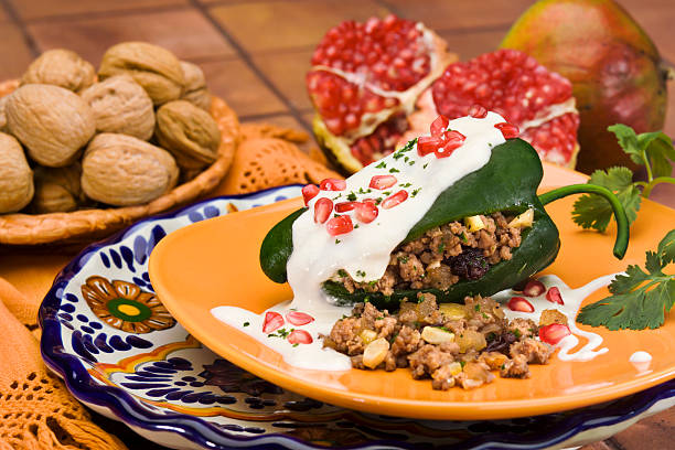 Stuffed green peppers with walnut sauce Typical mexican cuisine native to the state of Puebla puebla state stock pictures, royalty-free photos & images
