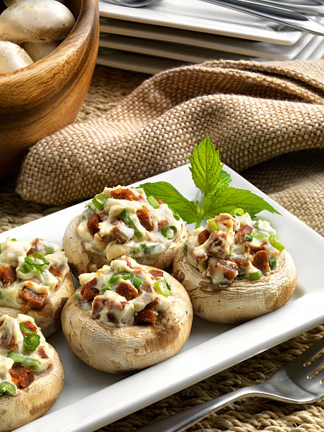 Stuffed Mushrooms Appetizer. Stuffed mushrooms with cream cheese, scallions, dried salami, baked.   burwellphotography stock pictures, royalty-free photos & images