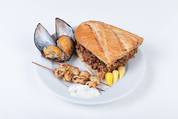 stuffed mussels and kokoretsi - kokoreç bildbanksfoton och bilder