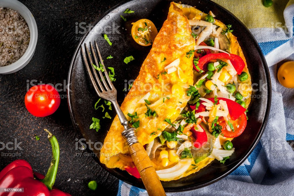 Stuffed omelette with vegetable stock photo
