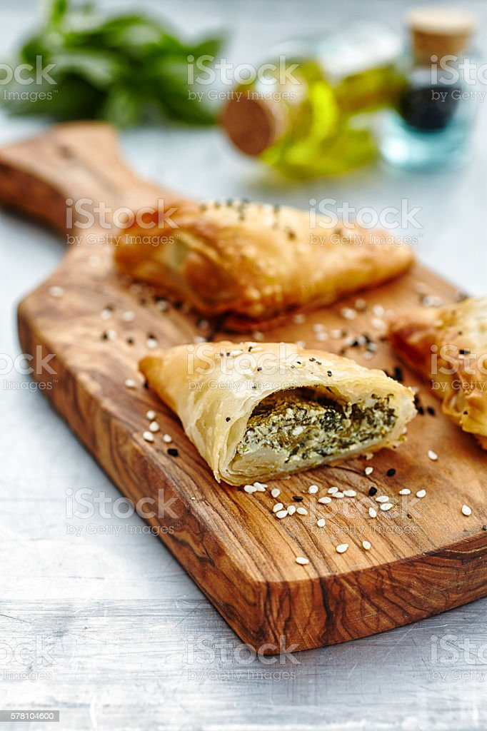 Stuffed pastry on wooden cutting board stock photo