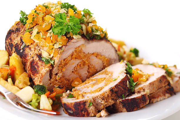 Stuffed pork roast with dried apricots and nuts. stock photo