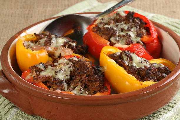 stuffed red and yellow peppers stock photo
