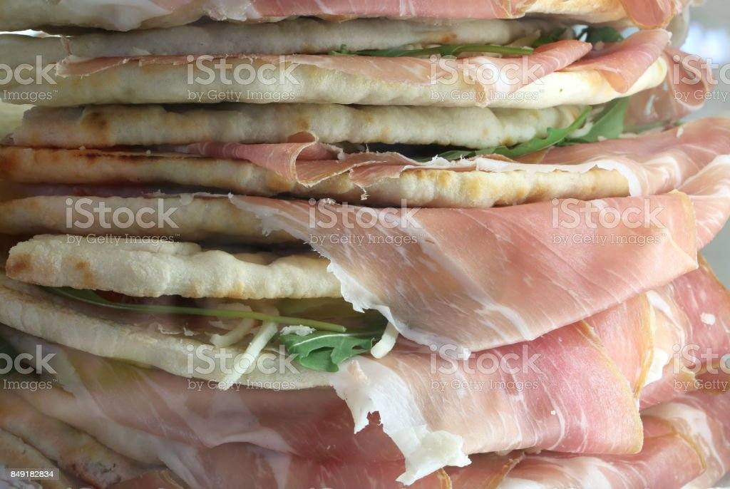 stuffed sandwiches called Spianata or Piadina in Italian with ra stock photo