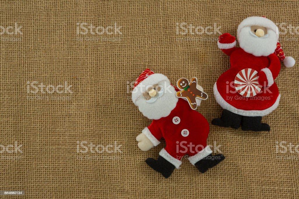 Stuffed Santa Claus on burlap stock photo