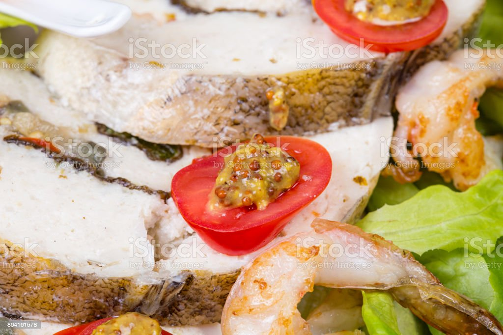 Stuffed seabass with shrimp and salad royalty-free stock photo