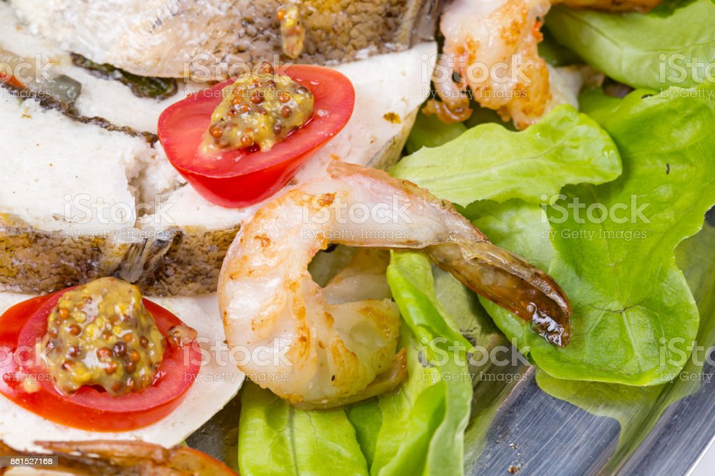 Stuffed seabass with shrimp and vegetables stock photo