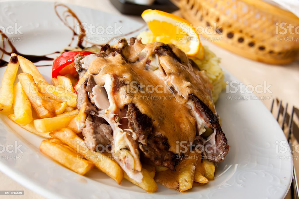 Stuffed steak with ham,cheese and french fries royalty-free stock photo