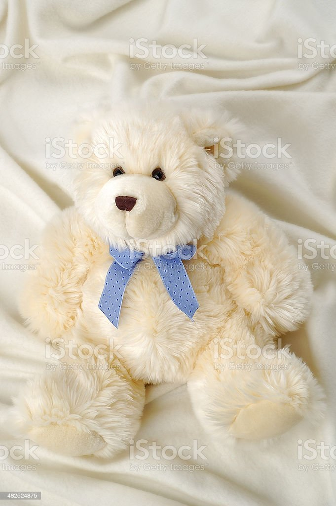 Stuffed Teddy Bear on soft blanket stock photo