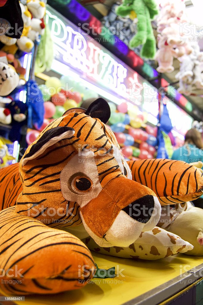 Stuffed tiger on a shelf at a carnival game stock photo