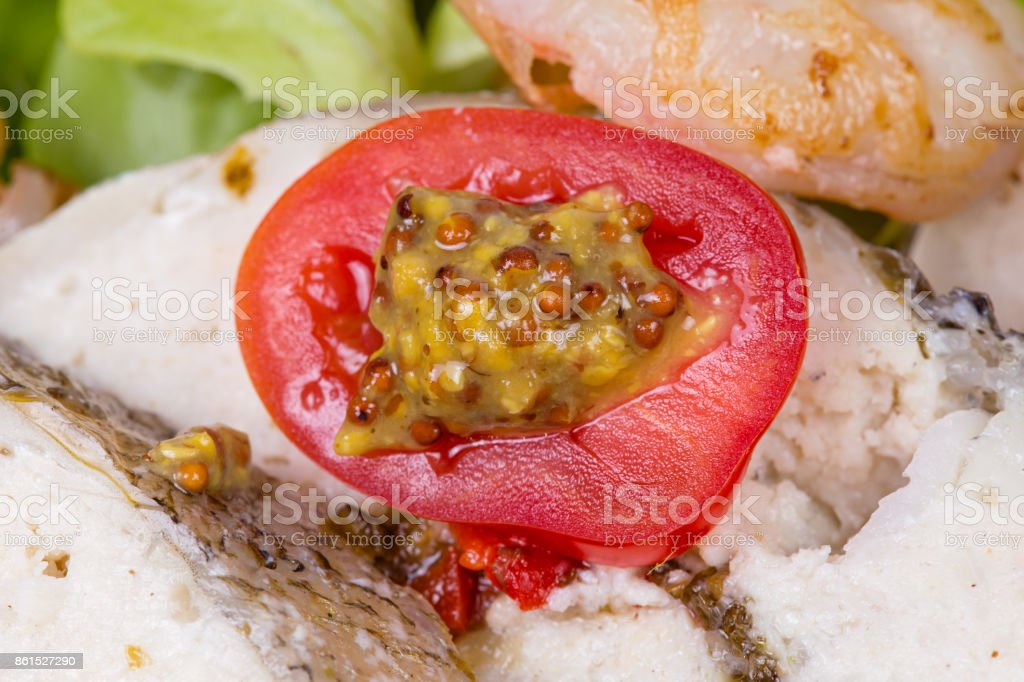 Stuffed tomato with salad and vegetables stock photo