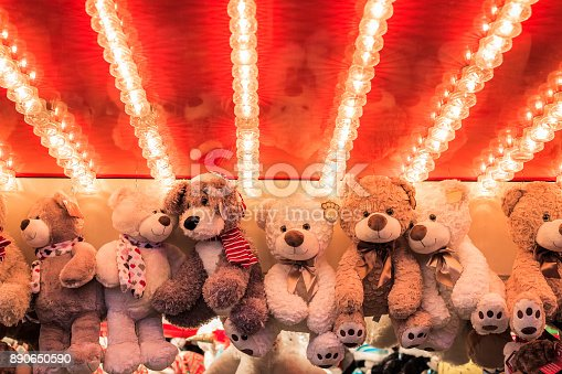 istock Stuffed toy bears on display awarded as winning prizes at Christmas funfair 890650590