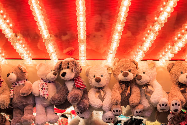 Stuffed toy bears on display awarded as winning prizes at Christmas funfair Stuffed toy bears on display awarded as winning prizes at Christmas funfair winter wonderland traveling carnival stock pictures, royalty-free photos & images