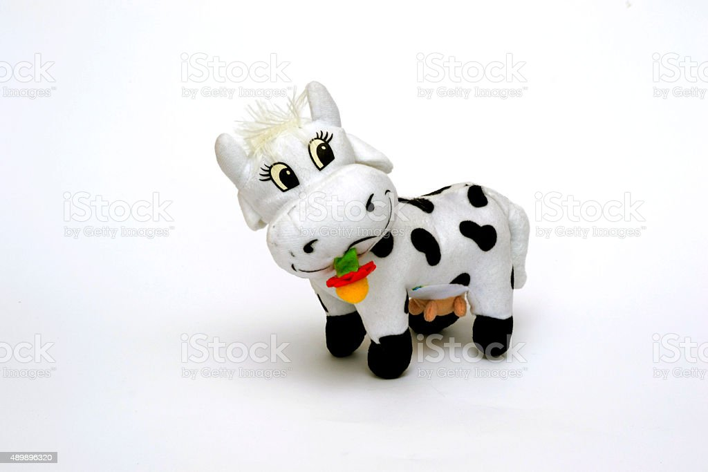 little stuffed cow on a white background.