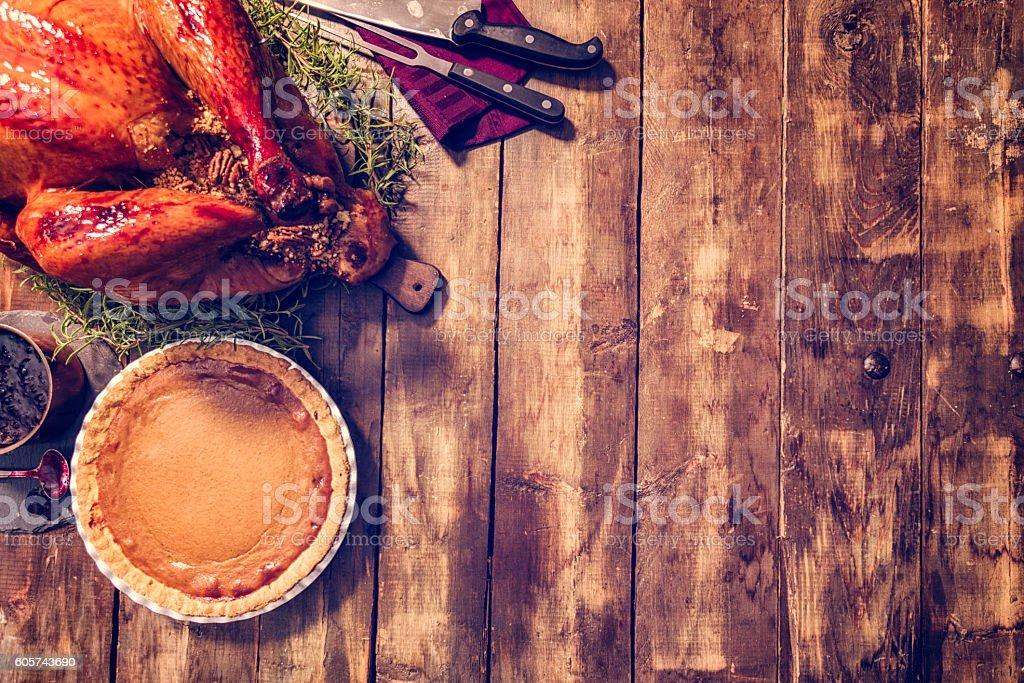 Stuffed Turkey and Pumpkin Pie Background stock photo