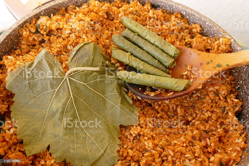 stuffed vine leaves with bulgur, grape leaves to make wrapping,a...
