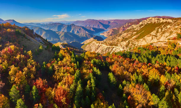 Stunning aerial view of lake Kozjak with mountain peaks around it in autumn. Stunning aerial view of lake Kozjak with mountain peaks around it in autumn. Drone photography. 4k resolution stock pictures, royalty-free photos & images