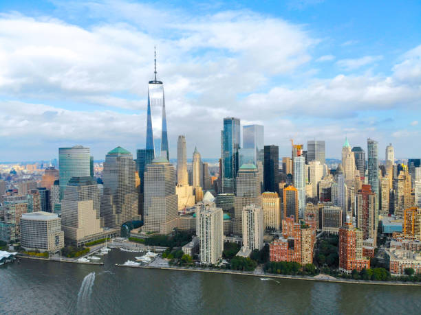 Stunning aerial view of Manhattan Skyline Stunning aerial view of Manhattan Skyline, with World Trade Center, New York, USA. Panoramic skyline with skyscrapers and financial district and Hudson river, New York, USA manhattan financial district stock pictures, royalty-free photos & images